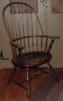 """Windsor Chair Sack Back Armchair cr"". Licensed under CC BY-SA 3.0 via Wikipedia - https://en.wikipedia.org/wiki/File:Windsor_Chair_Sack_Back_Armchair_cr.jpg#/media/File:Windsor_Chair_Sack_Back_Armchair_cr.jpg"